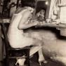 1920s-chorus-girl-applying-her-lipstick