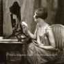 1920s-flapper-at-her-makeup-mirror