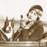 1920s-woman-in-auto-applying-makeup