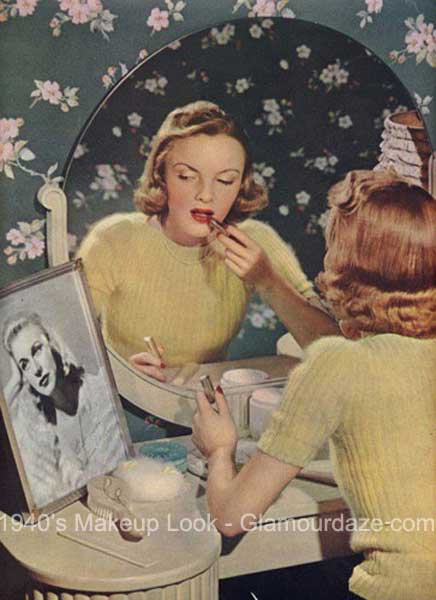 1940s-woman-applying-lipstick