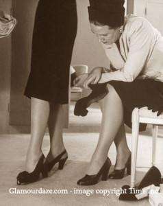Neiman-Marcus---1945---customer-shoe-shopping-