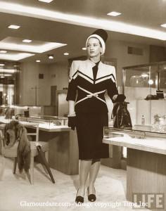 Neiman-Marcus---1945---woman-models-suit