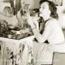 Paulette-goddard-applying-lipstick---1940s-makeup