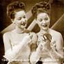 Twins-applying-makeup,-1940s.