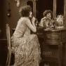 madge-bellamy-mirror--lipstick-1920s