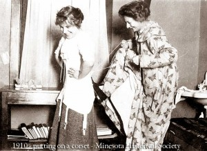 1910---putting-on-a-corset---Minesota-historical-Society