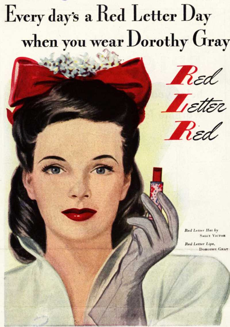 The vivid red of her dress is matched by Dorothy Gray Red Lipstick .