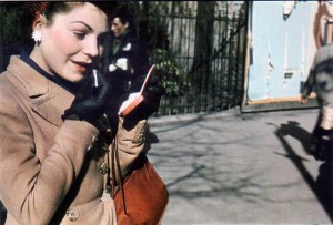 Woman-applying-lipstick--Paris-WWII---Andre-Zucca