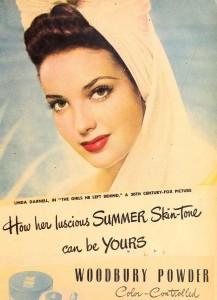 1940s-woman-applies-makeup-on-beach
