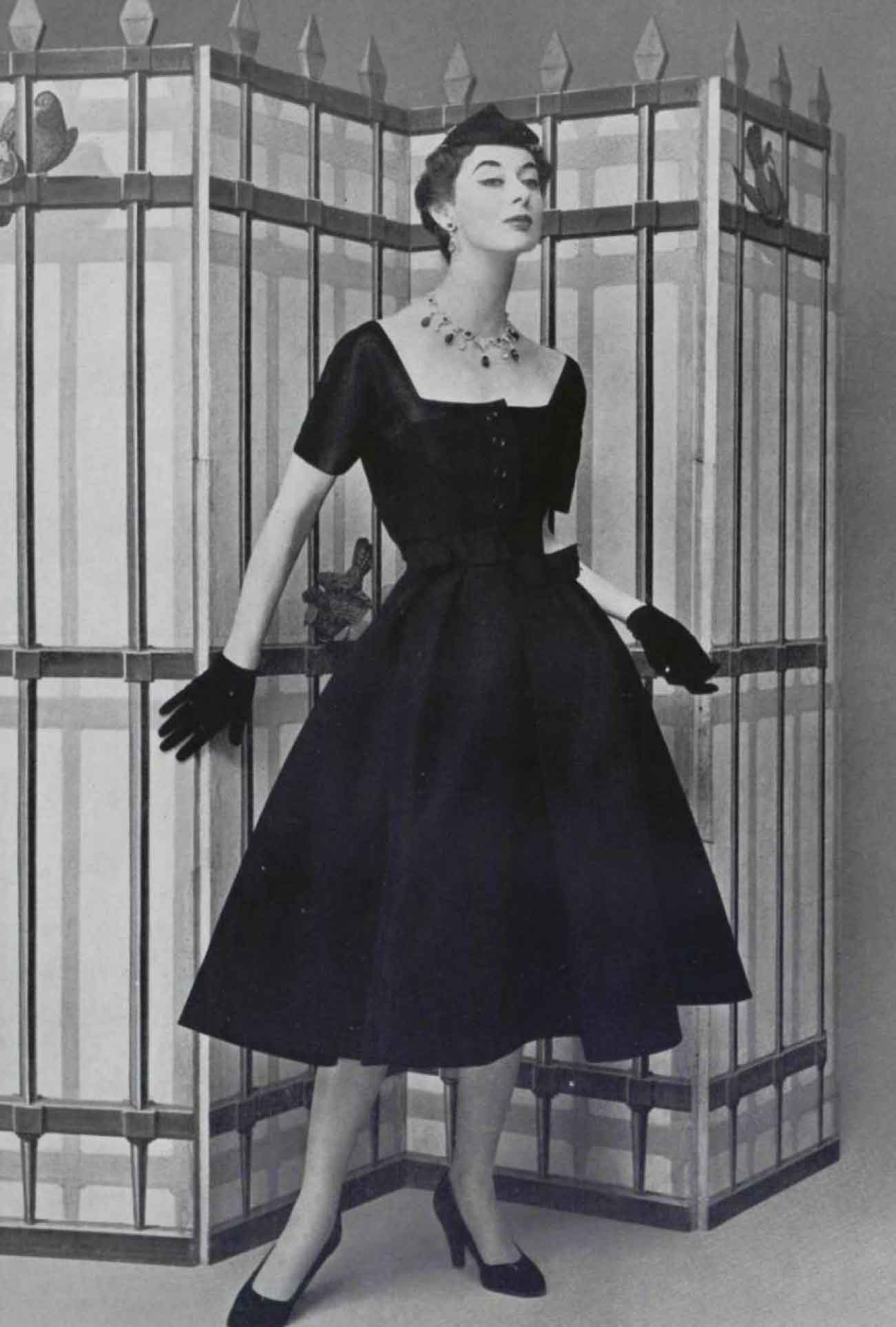 Jean Patou .A double belt ribbon marks the size of this dress .The ...