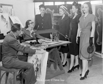Dorothy Shaver ( standing) discusses virtues and flaws of girls applying as models