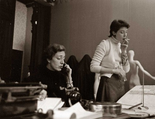 Model-Bettina-Graziani-at-press-desk---First-Givenchy-collection-1952
