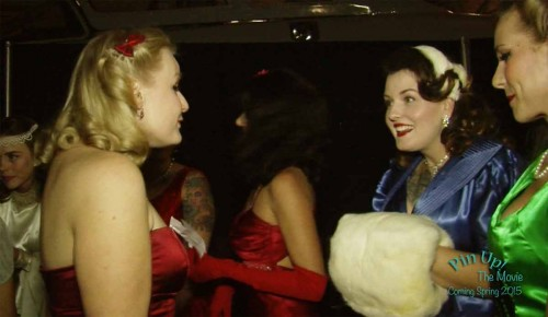 Miss-Emilie-and-Dapper-Dan-Doll-talk-backstage-before-the-1940s-and-'50s-White-Christmas-Ball-Pin-Up-Contest.-From-Pin-Up!-The-Movie.