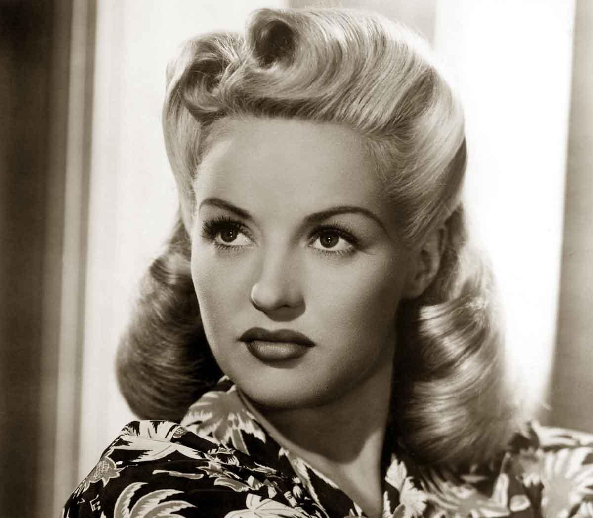 Wondrous 1940S Hairstyles Memorable Pompadours Glamourdaze Short Hairstyles For Black Women Fulllsitofus