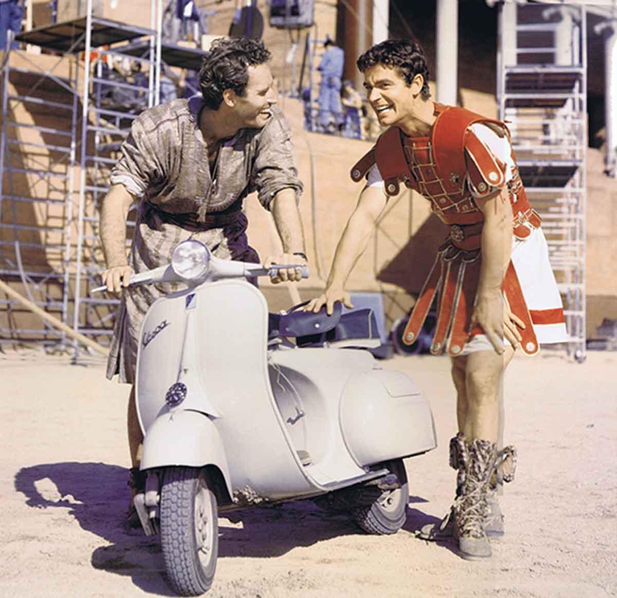 Charlton-Heston-and-Stephen-Boyd-with-Vespa---Ben-Hur-Set-1957