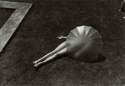 Martin Munkacsi - woman under umbrella 1935