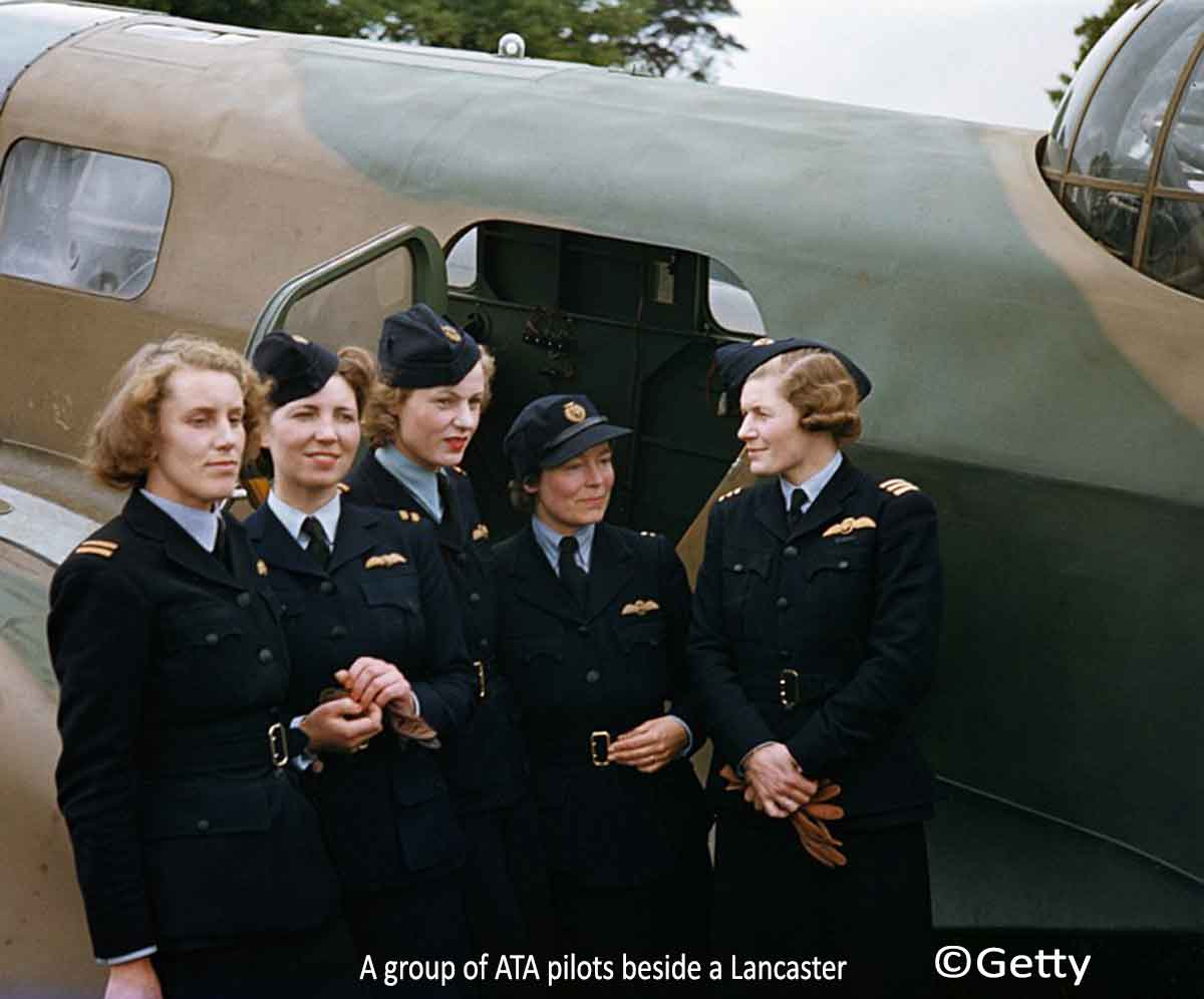 a-group-of-ata-pilots-beside-a-lancaster