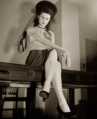 1940s stockings - 1942 woman inspects her Nylons - ©Time Inc