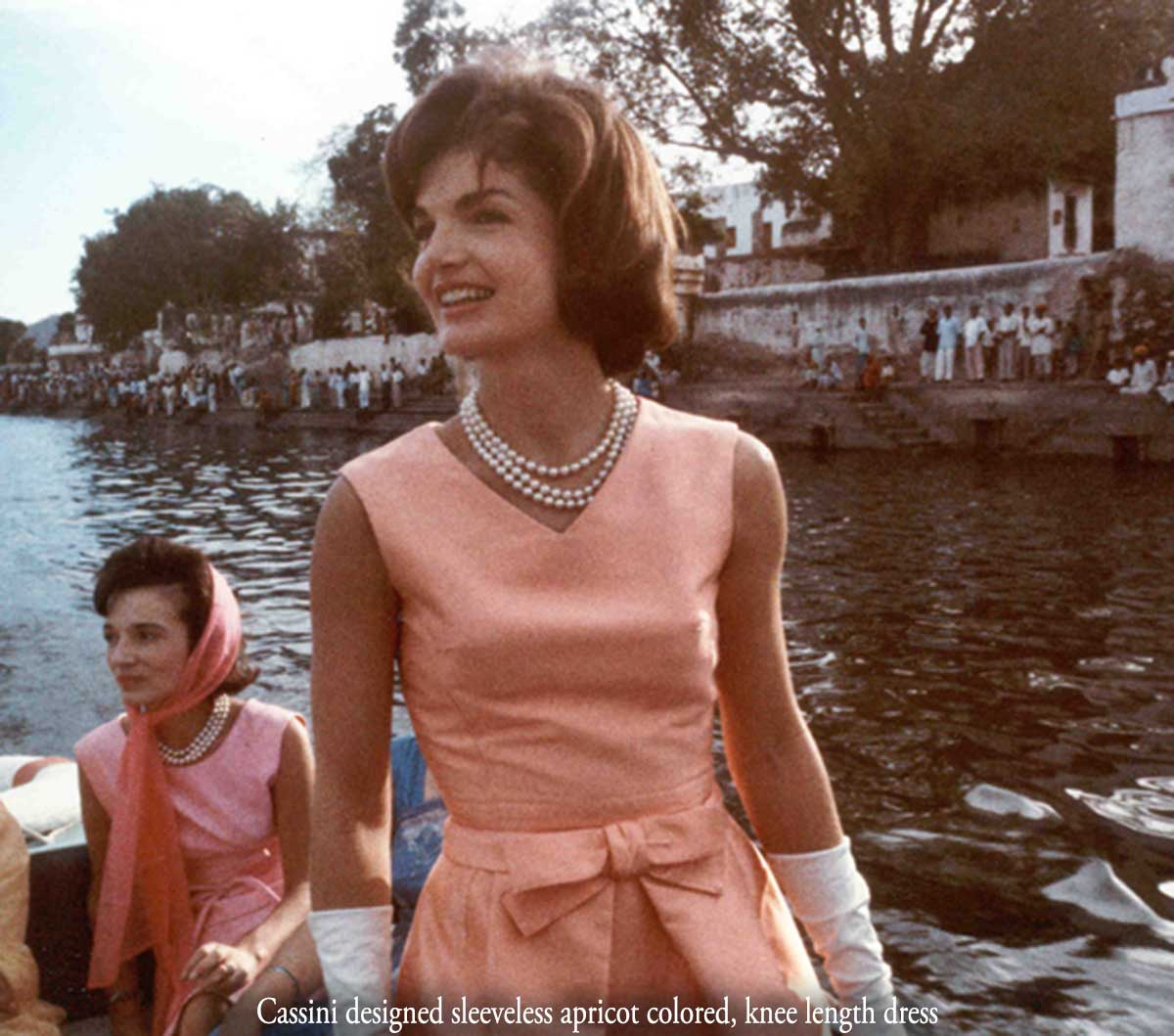 Jackie Kennedy wears a Cassini frock and pearl necklace - India 1962