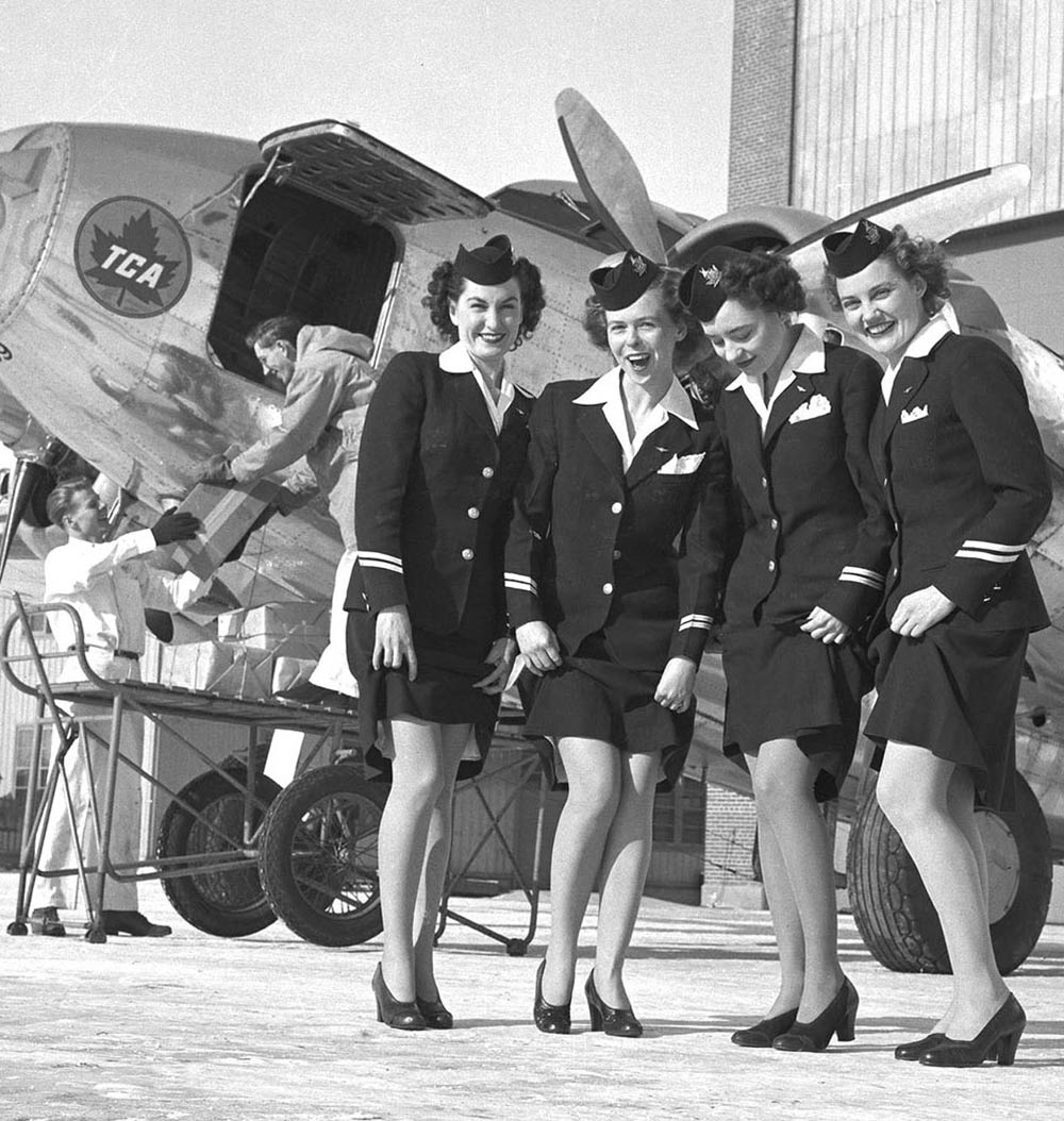 a-group-of-air-hostesses-show-off-their-nylons-in-1946---Air-Canada-Archives