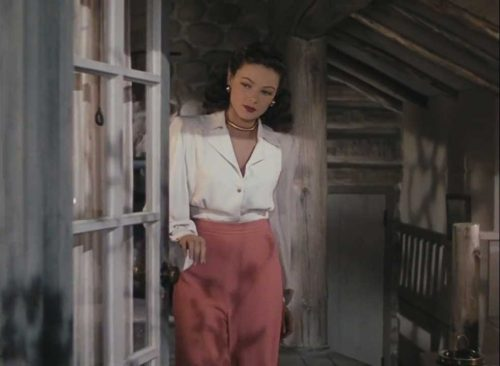 Gene Tierney - white-silk-blouse-and-high-waisted-wide-cut-coral-trousers 1945
