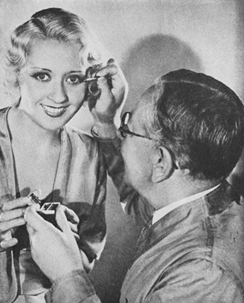 Max-Factor applies eye makeup to Joan Blondell