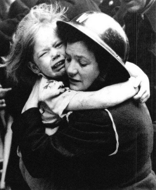 air-raid-warden-rescues-little-girl-during-bombing-raid-in-London