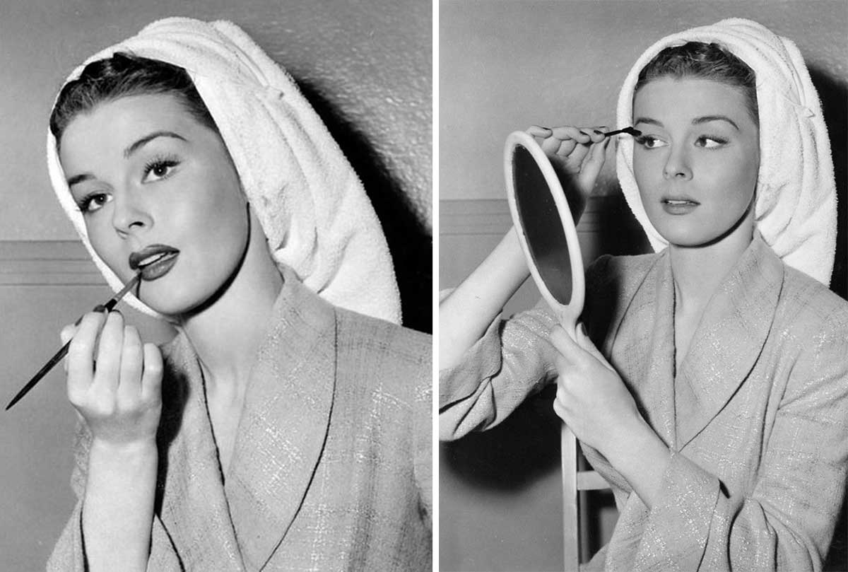 Elaine Stewart applying her makeup