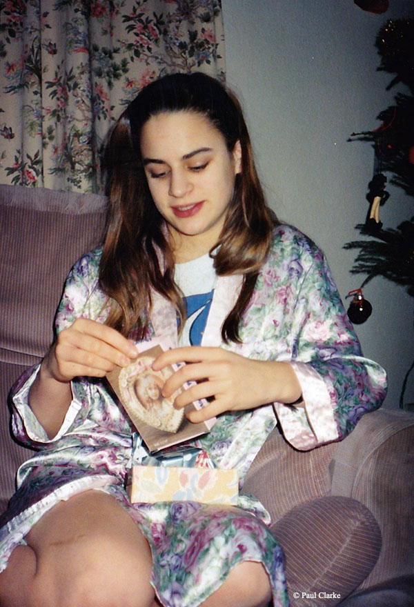 Gemma unwrapping Christmas presents in 1993
