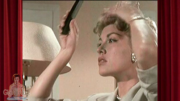 1950's woman fixes her hairstyle in the powder room